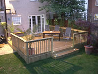 Log lap skirt to decking and balustrade