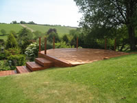 Softwood decking treated with a Cuprinol stain.