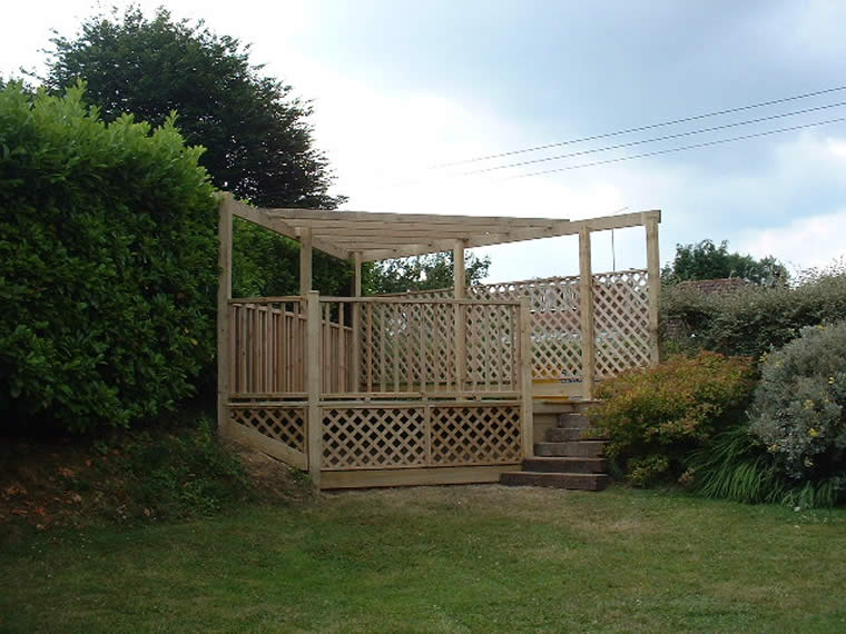 A raised deck covering an otherwise unusable corner of the garden