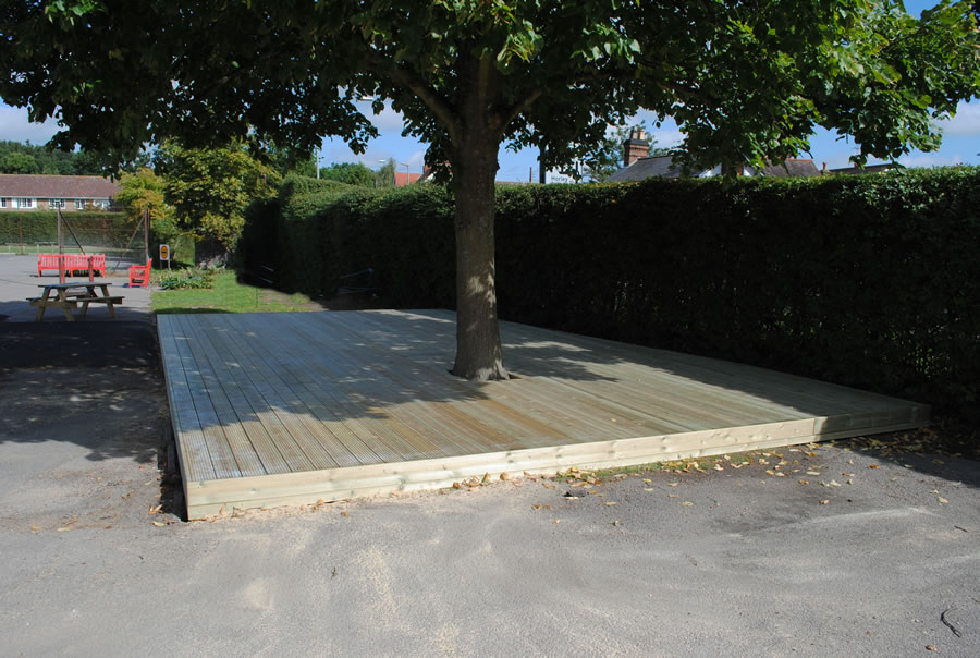 A neat softwood deck covering a patch of unuseable ground.